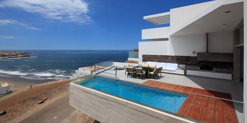 Vista del área de la piscina de la Casa de playa Las Palomas